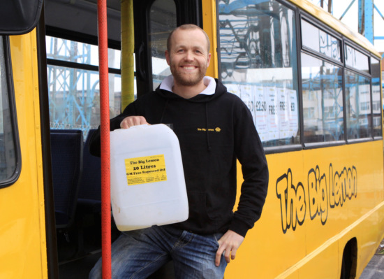Tom Druitt, founder of the Big Lemon Bus Company, a fleet of yellow buses that run on recycled cooking oil and offer cheap fares on routes dominated by students. Brighton, Sussex, England. Photo: Alec Kingham, M & Y Media