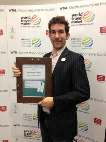Alexis Parkin collecting the Award