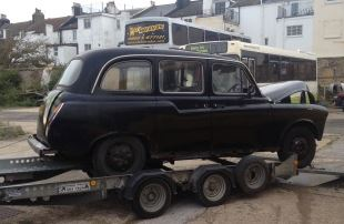 The black cab L589 HHV taken from our depot without being paid for.  The trailor has been hired from Universal Trailors 01403 782862