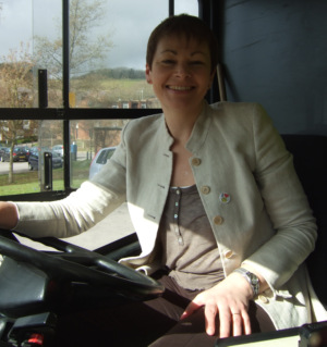 Caroline Lucas MP behind the wheel of a Big Lemon bus
